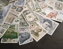 高盛12月22日撰文分析美国税改对美元的影响