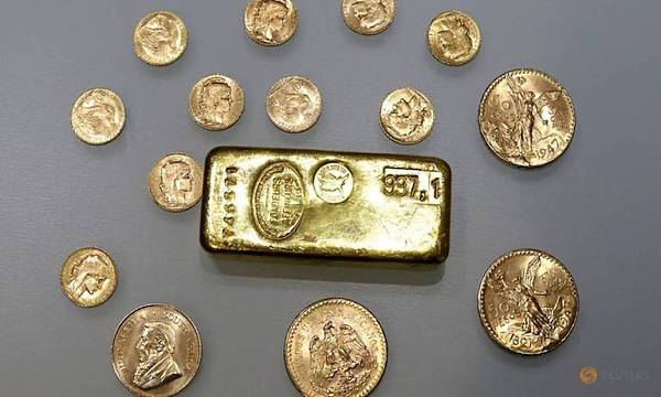 a-gold-ingot-and-gold-coins-are-seen-in-this-illustration-picture-4